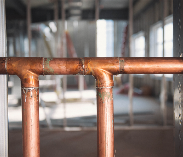 copper piping in a wall